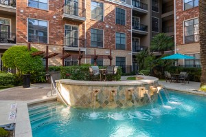 One Bedroom Apartments for Rent in Houston, TX - Up Close Pool Fountain & Seating Area (2)