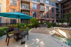 One Bedroom Apartments for Rent in Houston, TX - Up Close Pool Fountain & Seating Area