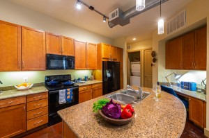 Two Bedroom Apartments for Rent in Houston, TX - Model Kitchen with Desk Nook, Double Sinks & Laundry Room View